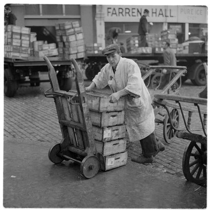 Porter outside Billingsgate Market; 1958.