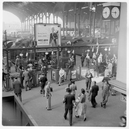Commuters at rush hour at a quarter to six; c.1960