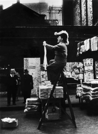 Market trading selling from the top of a stepladder: 1961