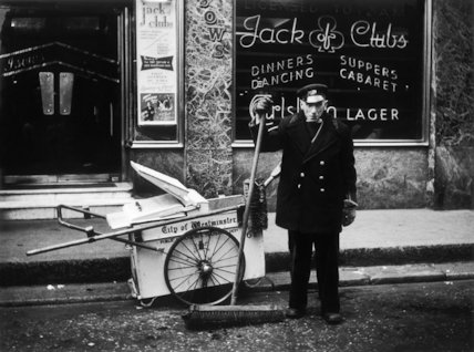 A street cleaner outside the Jack of Clubs nightclub: 1961