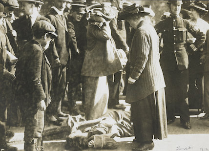 A suffragette falls to the ground following a confrontation with