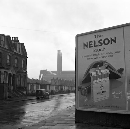 Street scene with advertisement poster. c.1955