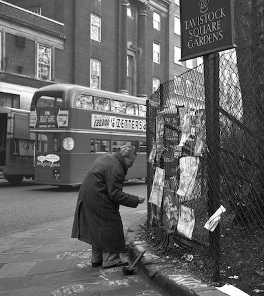 Man displaying chalk drawings. c.1955
