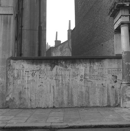Wall covered in graffiti. c.1955
