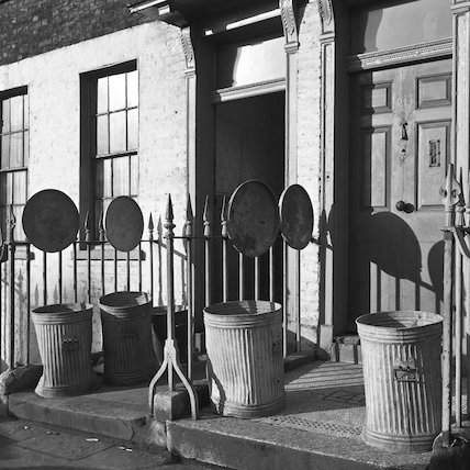 Dustbins outside the front doors of flats. c.1955