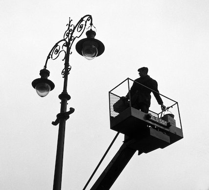 Man operating a cherry picker. c.1955