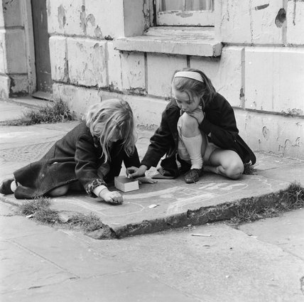 Two girls drawing with chalk; 1967