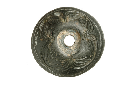 Circular black glass spindle whorl: 6th century