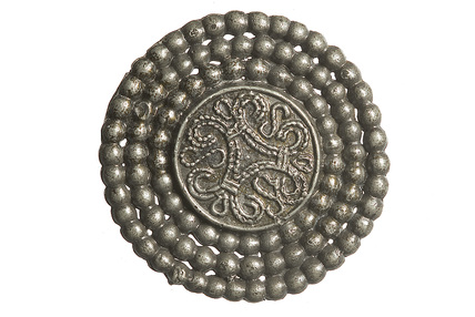 Pewter disc brooch: 11th century