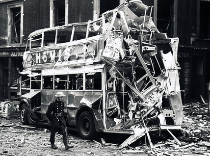 Bomb damage on a bus at Arthur Street by King William Street: 1940