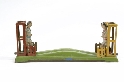 Mechanical penny toy football game: 20th century