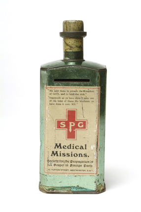 Metal money box in the shape of a medicine bottle: 20th century