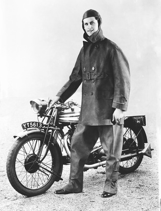 Image of a man modeling outerwear for Leslie Smith: 1930