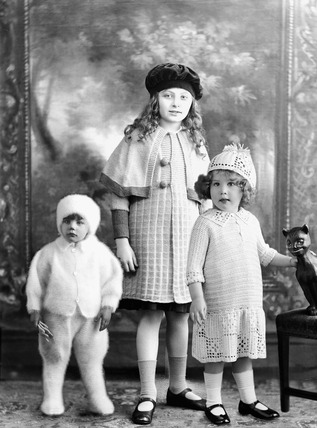 Montage showing three children modelling knitwear: 1920s