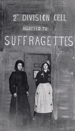 Photographic postcard of two suffragettes: 1908