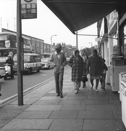 An Asian family walking down the street in Southall:1972