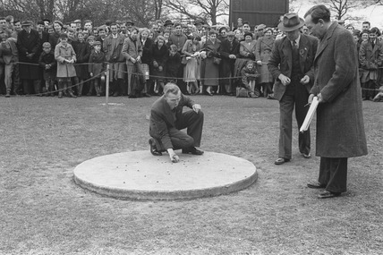 Crowd watching a marbles competition: 20th century