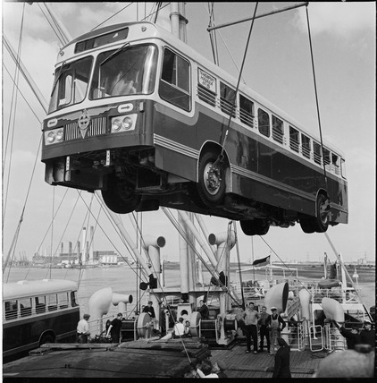 Loading a bus for export to Cuba: 1964