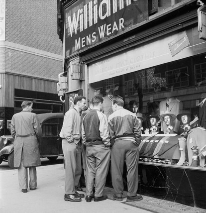 Men stand outside Williams and Co Menswear on the corner of Charing Cross Road: 1951