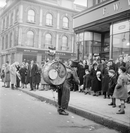 A one-man band in Camden High Street: 1952