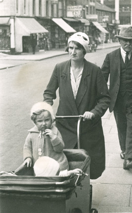 Woman pushing infants in a pram: 20th century