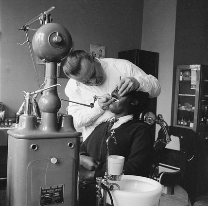 A dentist attends to his patient, Woodbury Down: 1961