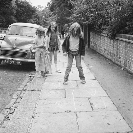 Children playing hopscotch in the street: 1970