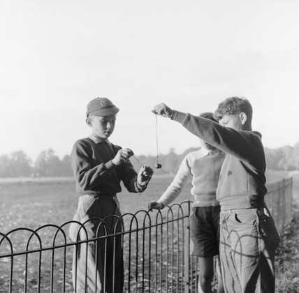 Boys playing 'conkers' in a London Park: 1957