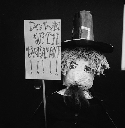 Guy Fawkes with placard: 1969