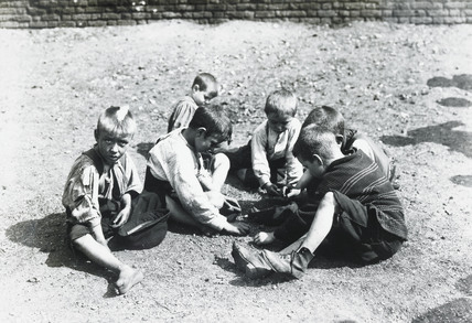 Boys playing near the river bank: c. 1900