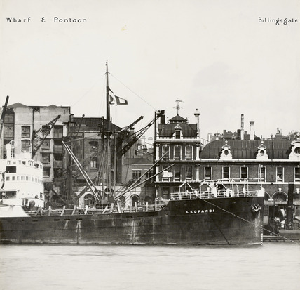 Thames Riverscape showing Nicholson's  Wharf and Pontoon, and Billingsgate Market: 1937