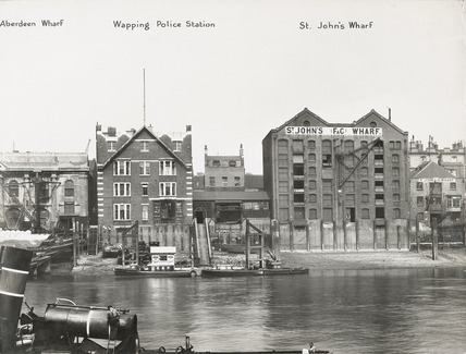 Thames Riverscape showing Aberdeen and St John's Wharves and Wapping Police Station: 1937
