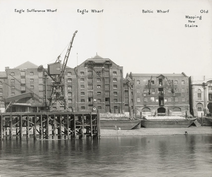 Thames Riverscape showing Eagle Sufferance Wharf, Eagle Wharf, Baltic Wharf and  Wapping New Stairs: 1937