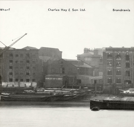 Thames Riverscape showing  Charles May and Son Ltd. and Brandrams Wharf:1937