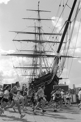 Runners in The London Marathon running past The Cutty Sark in Greenwich; 1997