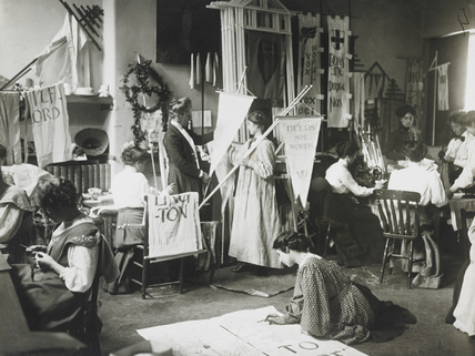 Suffragettes making banners: 1910