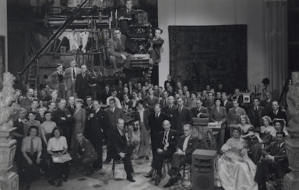 Cast and crew on the set of 'The Wicked Lady', including Margaret Lockwood