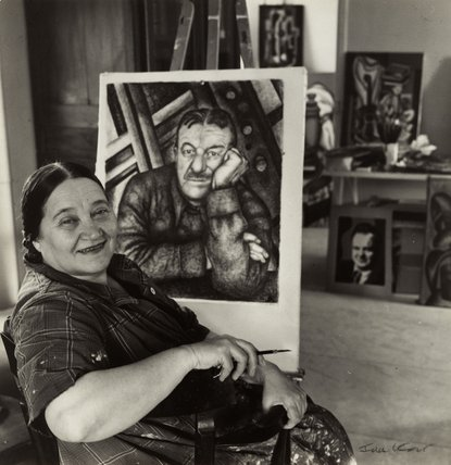 Nadia Khodossevitch-Léger with her portrait of Fernand Léger.