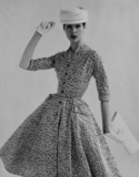 A full skirted dress with an abstract print, photo John French