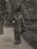 Walking ensemble of fur-trimmed jacket with belt, by Lucile