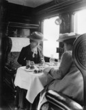 Female pasengers in a LNWR dining carriage, c 1905.