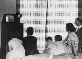A family watching a television broadcast, c 1930s.