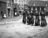 Five female fish-gutters, Whitby, North Yorkshire, c 1910.