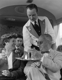 American tourists being served drinks on the 'Devon Belle', May 1953.