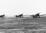 Three Spitfires at a Fighter Command statio
