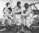 Woman pilots attaching their parachutes bes