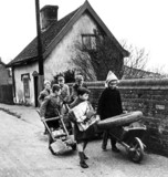 Children pushing wheelbarrows, 9 December 1