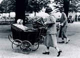 Nursemaids pushing prams in the park, c 1930s.