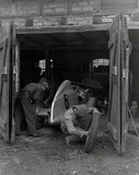 Mechanics working on Caracciola's racing ca