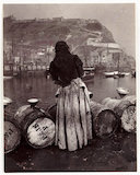 Woman and barrels, Whitby Harbour, c 1905.